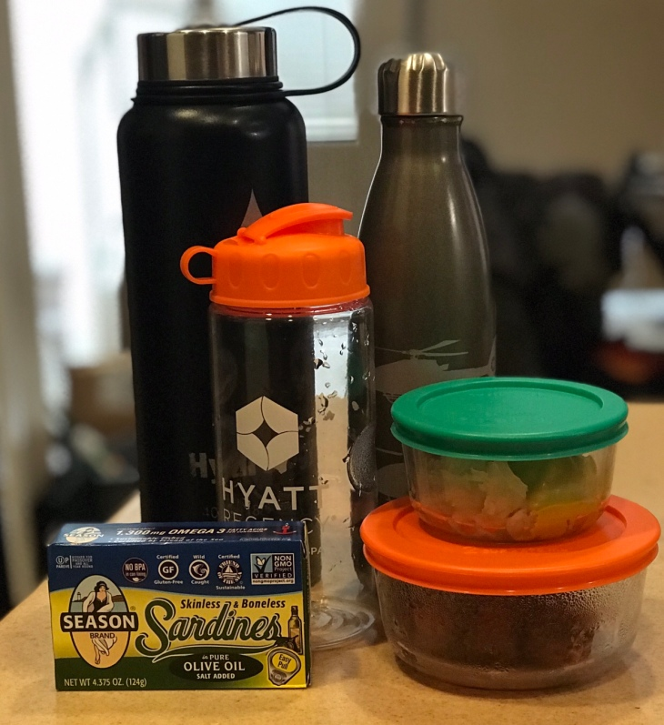 An example of my work food: my veggie shake, keto coffee, sardines, sausage, sauerkraut and, of course, my reusable water bottle.